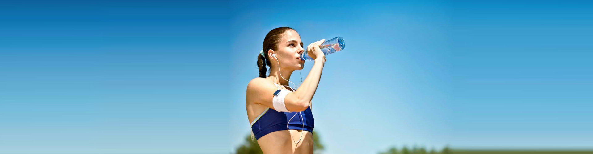 woman drinking her bottled water
