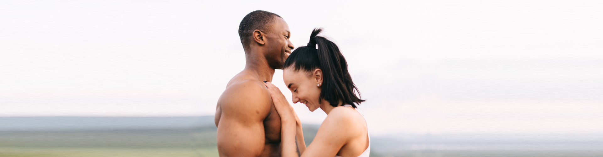 couple softly embracing on mountains